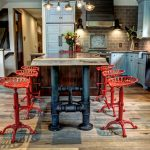 Industrial Kitchen With Red Bar Stools Pipe Legs Island Brown Tiles Backsplash White Kitchen Cabinets