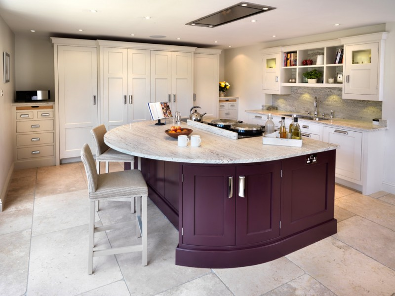 larger worktop kitchen island with under cabinets a couple of bar stools with back rest