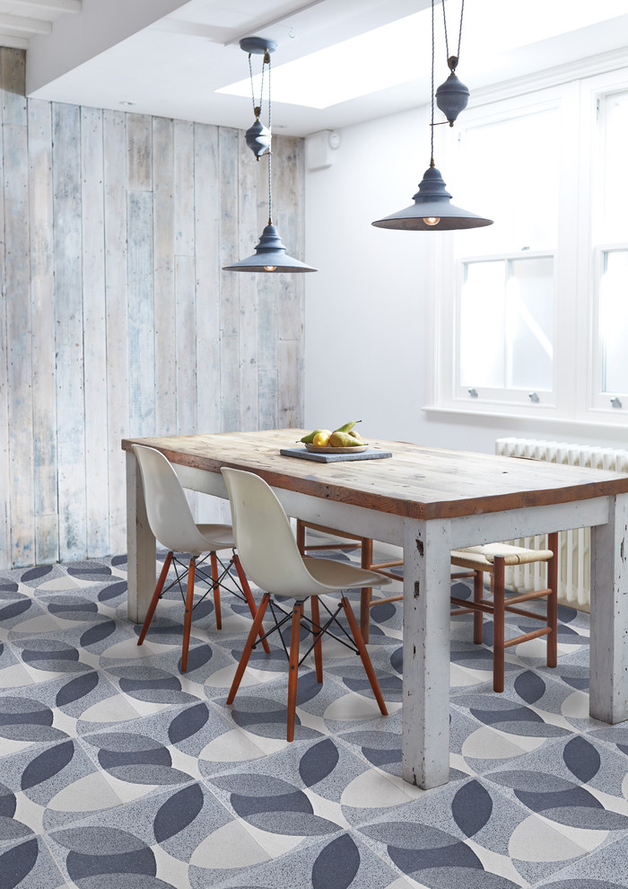 light & bright eat in kitchen with industrial touch industrial pendants kitchen island with blockbutcher worktop scandinavian style chairs cool pattern floors whitewashed pallet walls