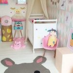Modern Chic Nursery Room Idea White Baby Crib Chic Colored Wallpaper Light Cream Bed Canopy's Draperies Animal Themed Area Rug