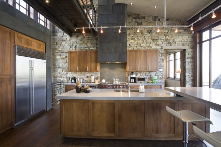 modern industrial kitchen design stoned walls recessed wood cabinets laminated top island modern stools