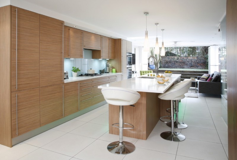 modern minimalist kitchen with light wood finishing larger kitchen island with white laminated worktop and modern white bar stools