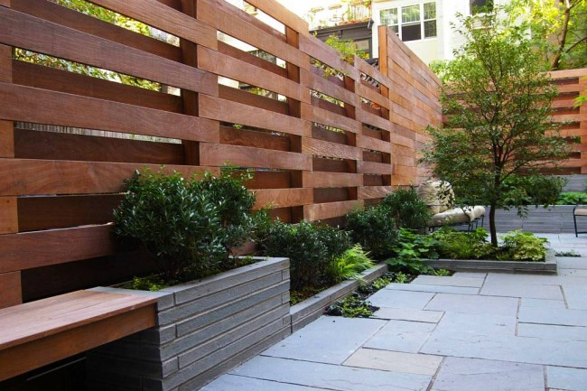 modern wood fences idea with concrete planters and additional wood bench
