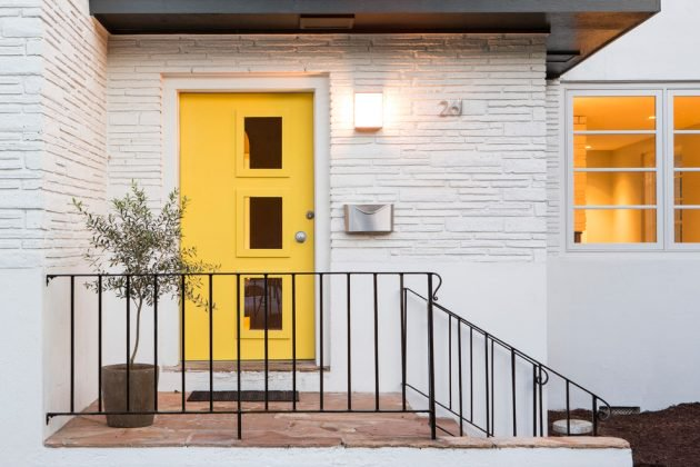 pop of yellow front door with glass window accents