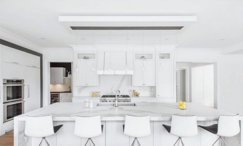 porcelain kitchen countertop in white white kitchen cabinets white porcelain island countertop white stools stainless steel kitchen appliances