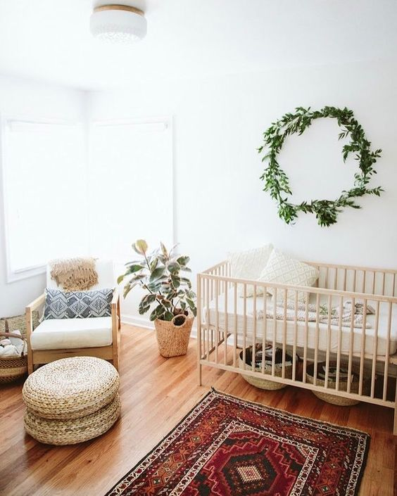 rustic boho nursery room idea ethnic area rug light wood baby crib light wood nursery chair natural fiber made pouch light wood floors