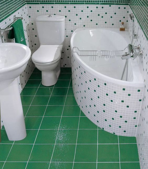 small bathroom in pop of green color green tiles flooring green mosaic tiles walls white mosaic tub and walls with green square accents