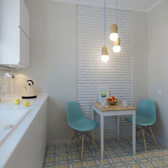 small breakfast nook baby blue dining chairs with wood angled legs small dining table with wood top multicolored tiles floors white brick like wallpaper modern pendants
