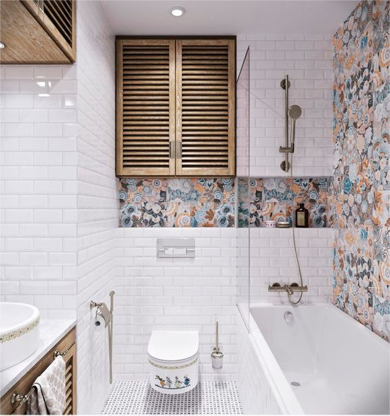 small modern bathroom design window like cabinet multicolored wall accent white subway tiles walls mosaic tiles floors wall mounted toilet white bathtub with half way clear glass panel