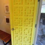 Textured Yellow Front Door With Simple Doorknob