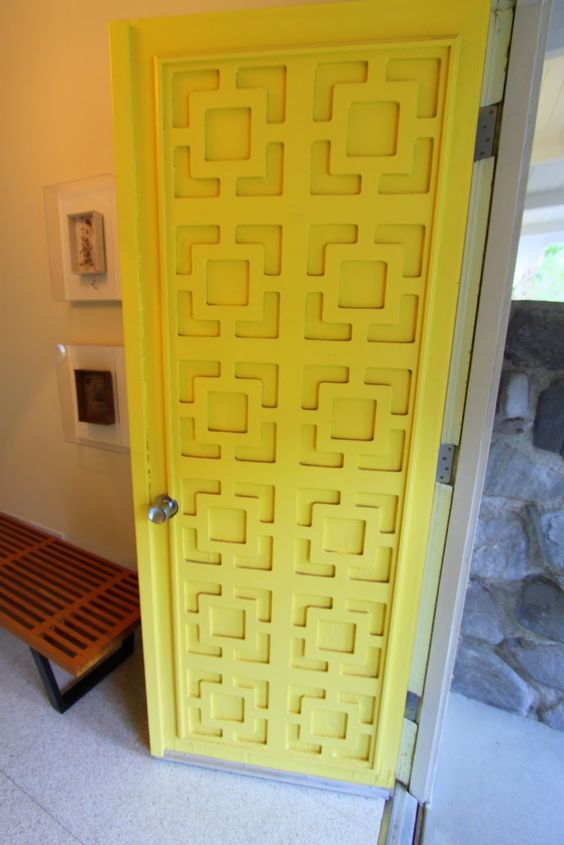 textured yellow front door with simple doorknob