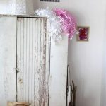 Whitewashed Closet With Pink Accent Color In The Corner