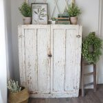 Whitewashed Storage Station With Green Wreath & Little Houseplants