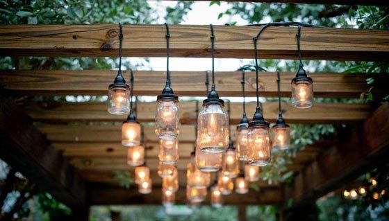 wood pergola with vintage lamps
