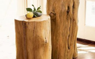 a couple of tree trunk side tables