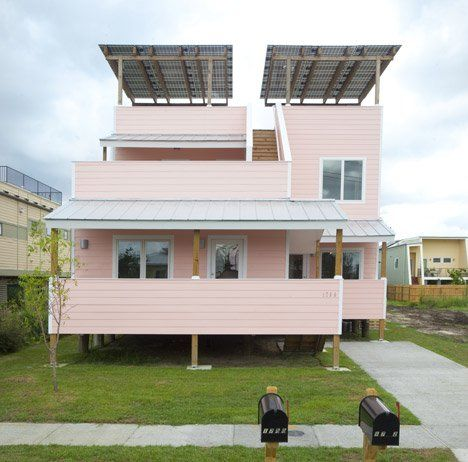 affordable & sustainable house design with solar panel roofs fibre concrete board exteriors and pink exterior