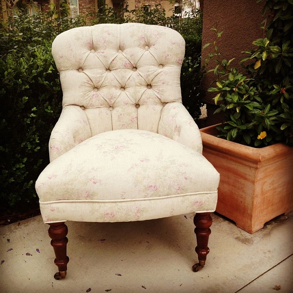 arm less chair with creme tufted upholstery