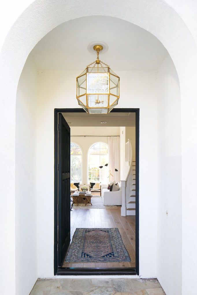 coastal bohemian entryway idea Moroccan inspired pendant with gold finishing & clear glass Moroccan runner black front door