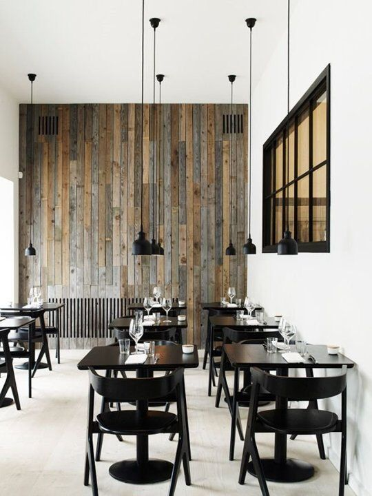 commercial coffee shop with urban & industrial features black finish coffee table and chairs longer wired pendants in matte black wood slats walls b