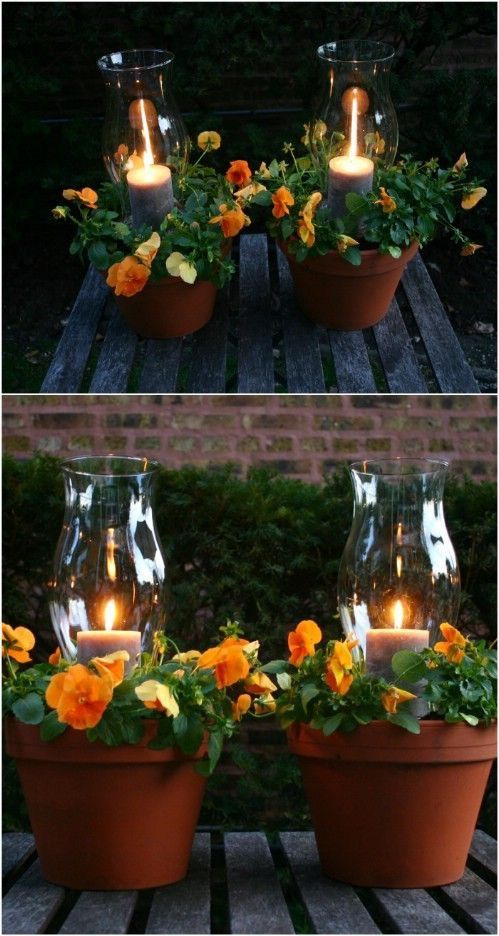 creative centerpiece made of clay burnt planters flowers and centered glass candle holders