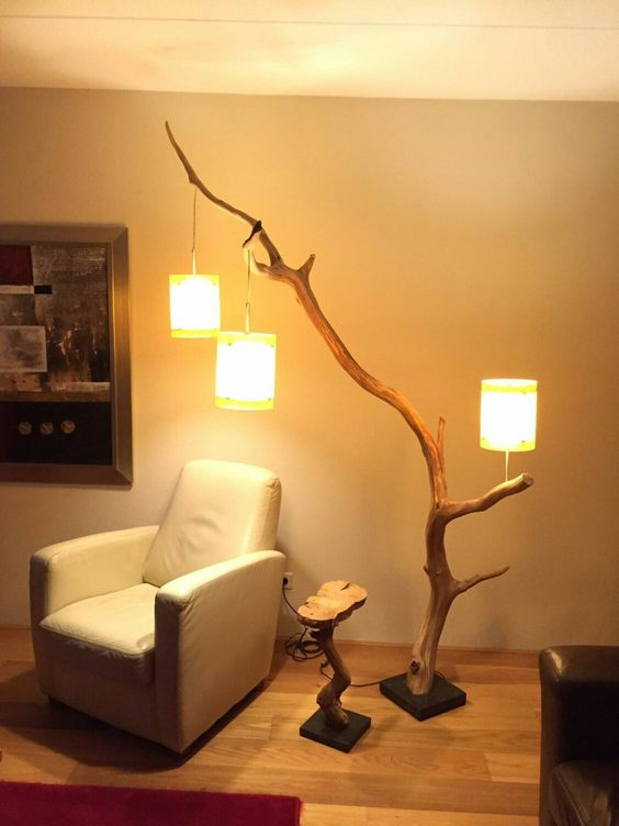creative tree trunk floor lamp with three lantern lamps white leather armchair tree trunk side table