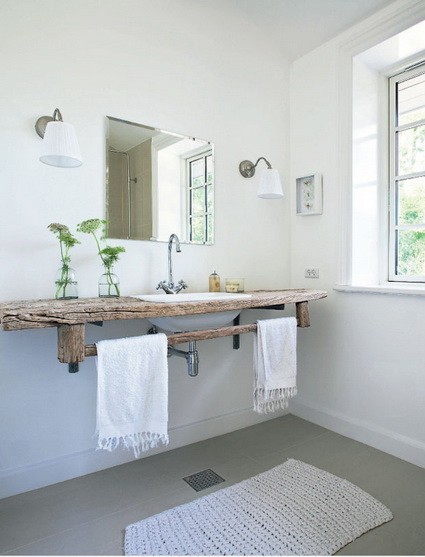 dominant white bathroom design rustic vanity countertop with towel holder addition frameless mirror a couple of vanity sconces white bathroom mat