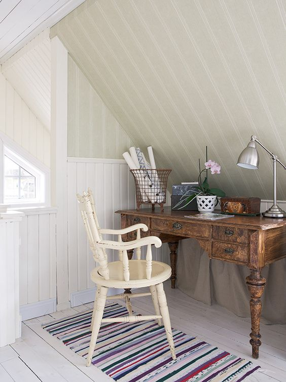 farmhouse home office in attic antique wood working desk vintage chair in white striped runner with fun colors