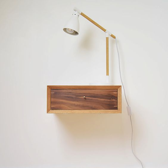 floating oak nightstand with minimalist table lamp