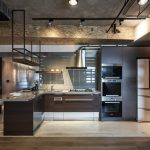Industrial Kitchen Design With Urban Appeal Recessed Stainless Steel Appliances Hanging Black Wrought Iron Shelving Units Ultra Modern Kitchen Bar