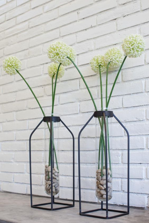 iron plant stands with glass tubes inside