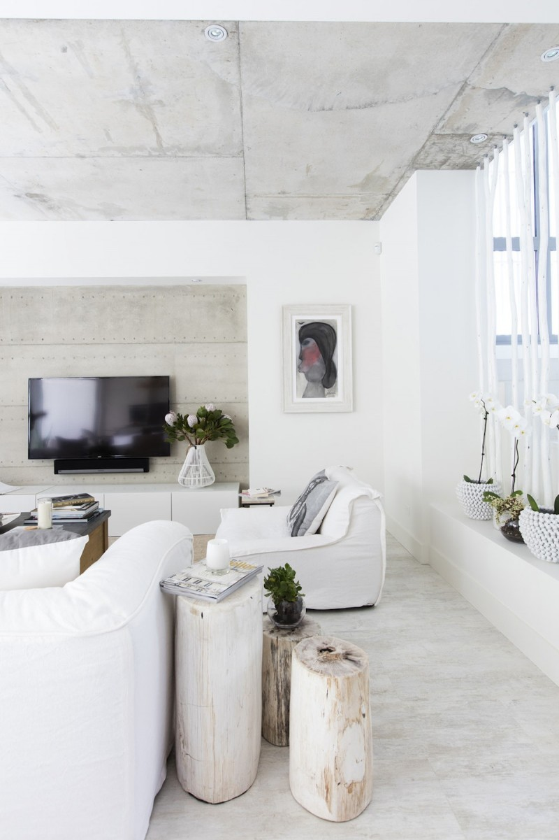 lighted fill living room pale wood stools modern white furniture set white walls concrete ceilings