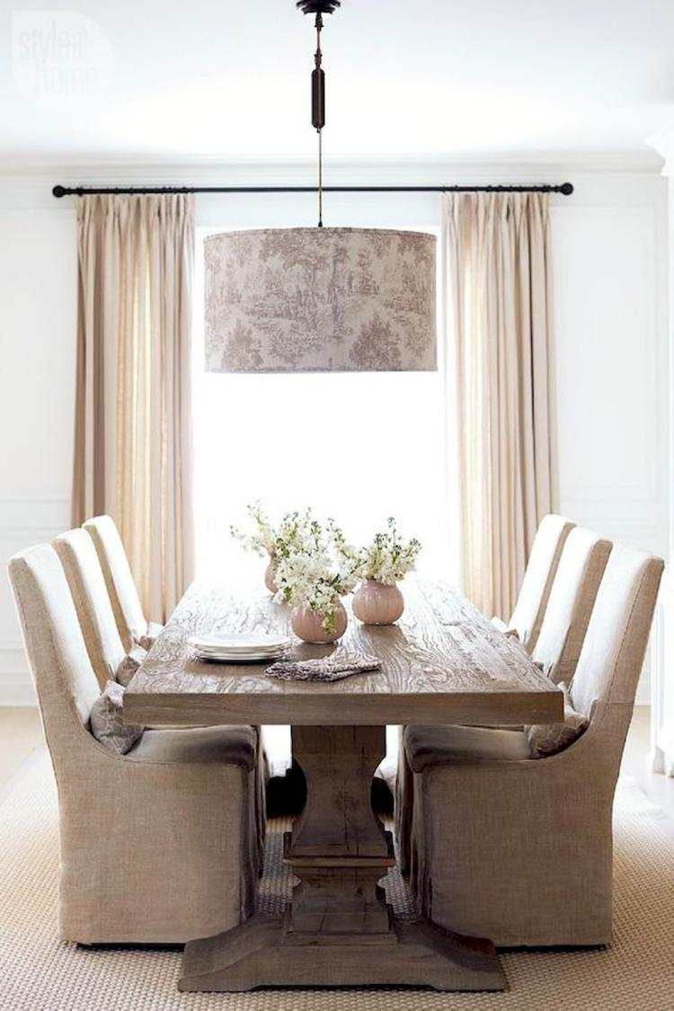 lighter rustic dining room cream dining chairs light wood dining table cream window draperies oversize pendant