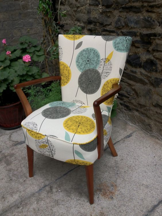 mid century modern chair with floral fabric upholstery
