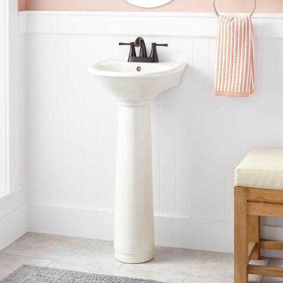mini pedestal sink in white with black finished faucet