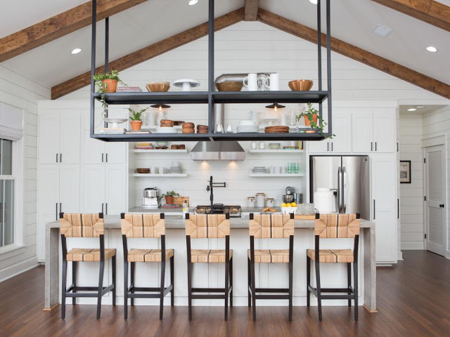modern farmhouse kitchen bar with industrial touch hanging black iron racks taller cabinets in white taller kitchen racks modern bar stools wood floors
