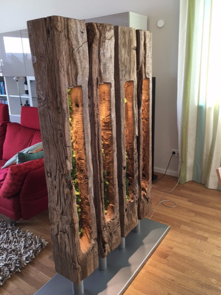 old oak beam room divider with light source inside