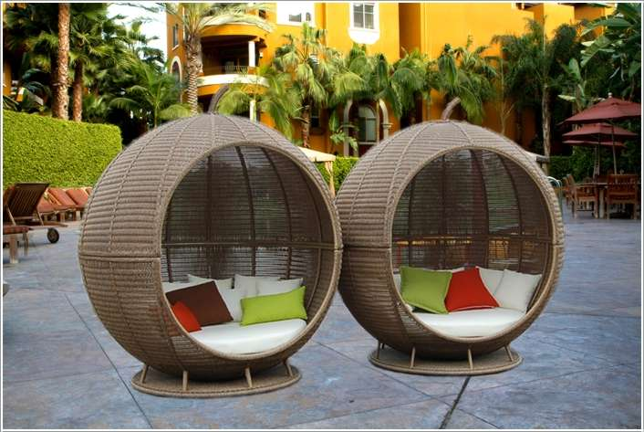 outdoor ball wicker chairs with colorful throw pillows and white upholstery inside