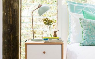 retro style nightstand idea dusty blue table lamp striking blue pillows