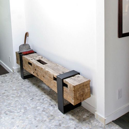 rustic bench with black metal supports