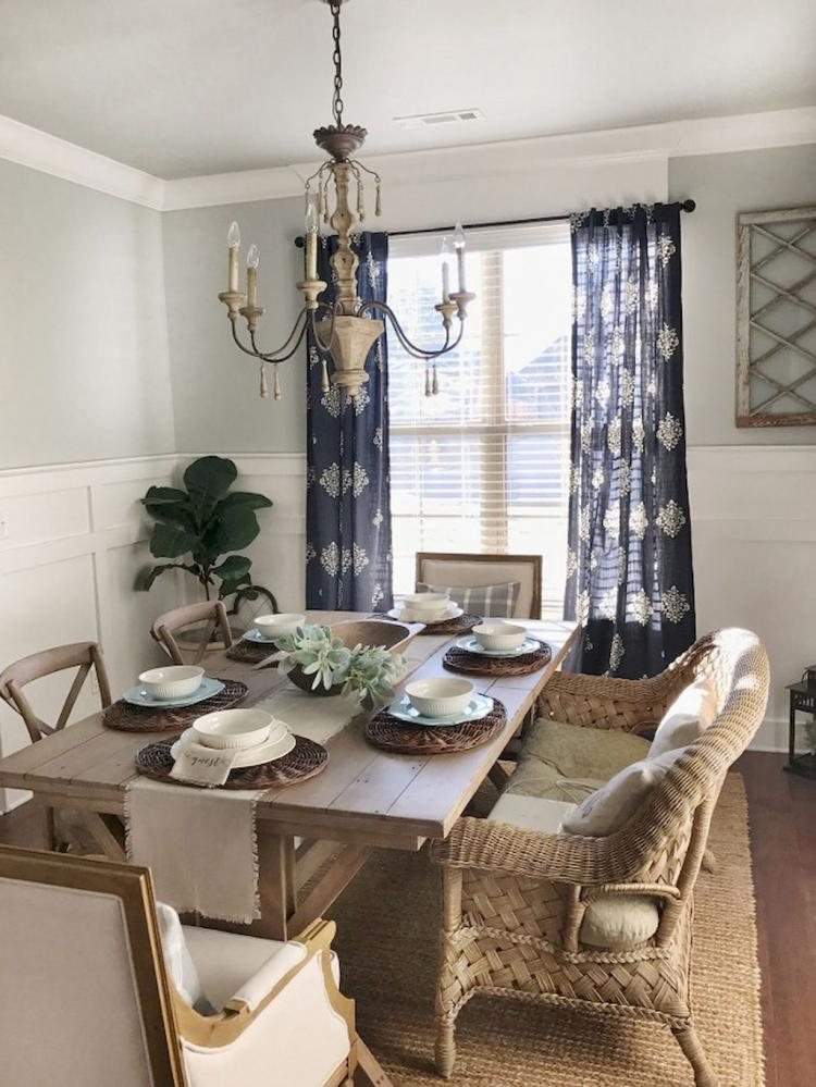 rustic dining room deep blue drapes with white prints wooden dining table wooden dining chairs woven sofa woven area rug