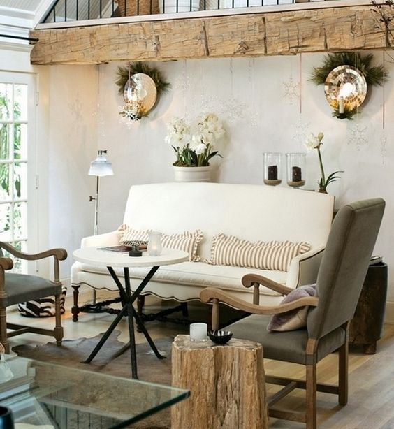 rustic farmhouse living room design with decorative raw wood panel addition a pair of wall mounted candle holders white sofa with striped throw pillows
