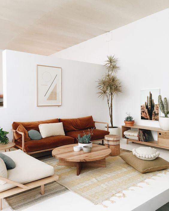 scandinavian living room darker brown sofa light wood coffee tabe modern area rug in soft neutral light wood recliner
