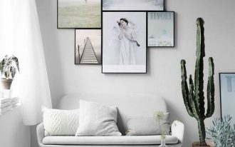 small and minimalist living room black framed photography modern white living room set medium size succulent on po white area rug white pouf