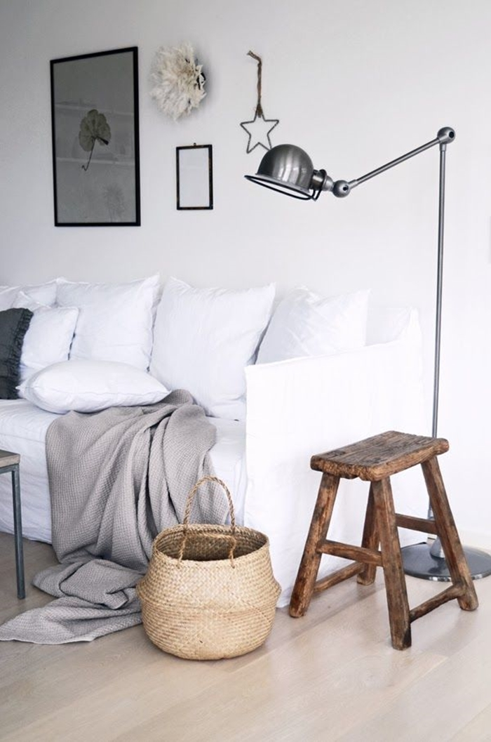 small neutral living room white sofa wooden bench side table modern floor lamp light wood floors