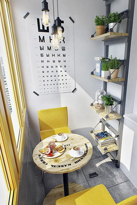 sunny enclosed balcony small seating nook consisting sunny yellow chairs round top coffee table wall mounted rack with potted plants industrial style pendants