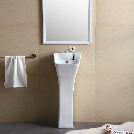 ultra tiny pedestal sink in white white framed mirror stainless steel towel bar warm toned walls