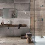Urban Industrial Style Bathroom Design Concrete Walls Wood Floors Clear Glass Shower Panel Heavy Wood Countertop Wood Stool
