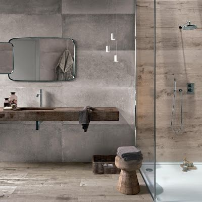 urban industrial style bathroom design concrete walls wood floors clear glass shower panel heavy wood countertop wood stool