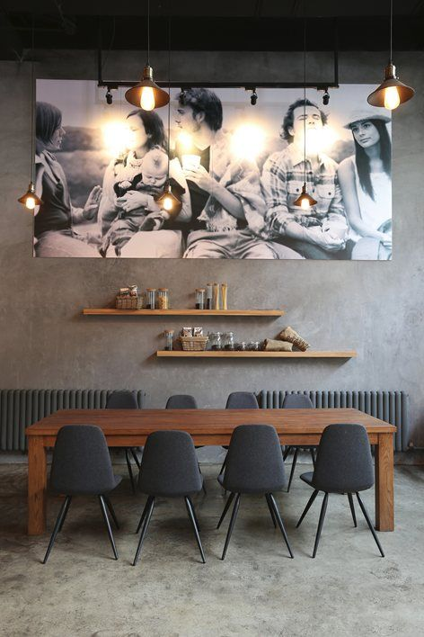 urban style dining room wall mounted wooden shelves wooden dining table scandinavian style chairs in gray overlooked photograph