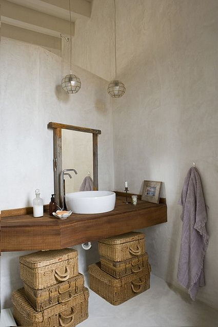 wall mounted wood vanity in rustic style some woven baskets for storage wood framed mirror